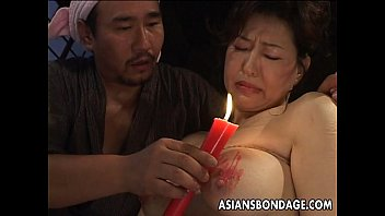 Asian lady mature Tied up and waxed by her dominant master
