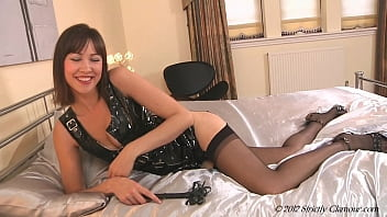 Manipulating Mistress Carole Continues To Dominate Her Slave Getting On The Bed Whipping Her Self Then Slowly Zipping Off Her Sensual Rubber Dress Showing Her Nice Firm Tits