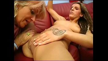 Mature slut and y. bitch with tattoos lick each other's pussy