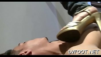 Breathtaking honey dominates dude and give a steamy footjob
