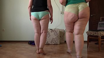 Two mature BBWs with juicy PAWG do home fitness and gradually undress. Shows plump legs in socks and hairy pussy. Amateur fetish and foot fetish.