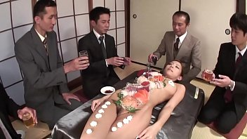 Business men eat sushi out of a naked girl039s body 2