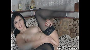 Cute brunette plays with her pussy on webcam