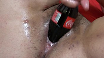 Fat lesbian in a gymnastic pose, and a girlfriend with a big dildo fucks her hairy pussy. And masturbation with a bottle of Coca-Cola. Fetish with a deep, wide hole in a thick cunt.