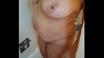Check out my wife. Quick shower show. Wife wanted to give you something new.  Shows us her huge wet tits and ass.