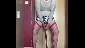 crossdressing sissy rides a dildo stick then shoots his load on the floor unexpectedly