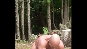 Muscle slave Tries to Move a Rock
