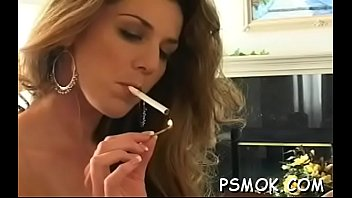 Mature bitch blows a boy while smoking a cigarette