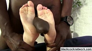 Sexy young blonde interracial footjob