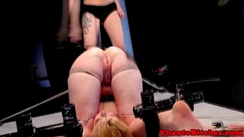 Lezdom mistress uses a paddle on her sub