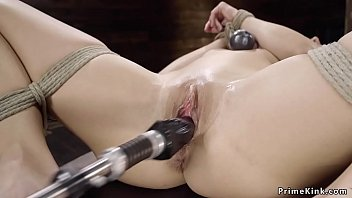 Small tits babe in bondage fucks machine