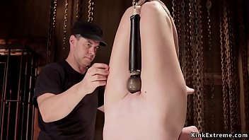 Slave in pink thong gets ass caned