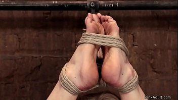 Blonde slave is hung for hips