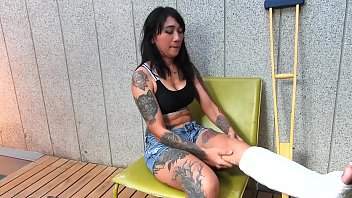 Ude asian capital Tattooed asian model with short cast leg