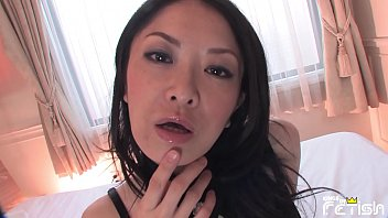 Beautiful Japanese MILF with big boobs in a black outfit fingers herself