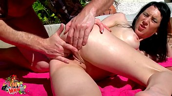 Skinny Milf babe gets oiled and fucked by the pool