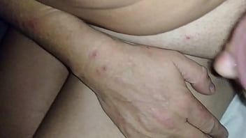 Wife hooks up hubby with a reach around