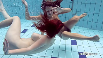 Two sensual babes Lucy and Katrin swimming naked