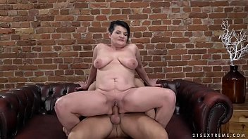 Pierced granny pussy filled with younger dick