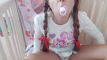 the diaper and the pacifier are excited and now the little girl will learn to give herself pleasure