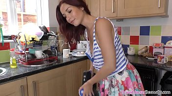 Hot red head hair girl cleaning the kitchen
