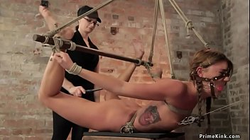 Gagged lesbian in hogtie zappered