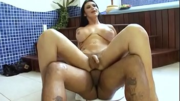 Brunette tranny with big boobs plays with her cock in the jacuzzi