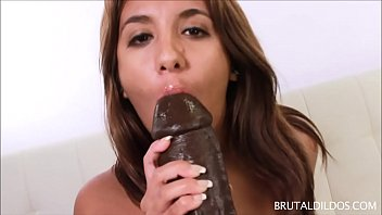 Brown and pink pussy - Chubby brunette lola feeds her pussy a fat brown dildo