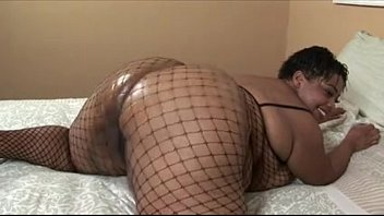 Madame Trixie In Fishnet Body Stockings