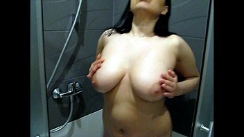 Girl masturbation in the shower with milk