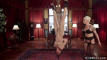 Upside down suspended babe ass whipped