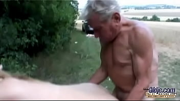 Busty boobarella Tiana Wolf fucking an old man in the woods