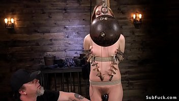 Tied up blonde holds bowling ball