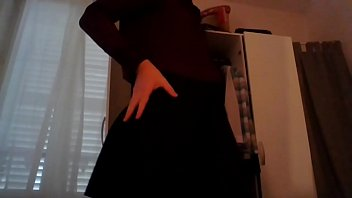 Young amateur cross dresser secretary teasing in sexy blouse and cute black skirt back from the office
