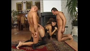 The babe strokes two members immediately on his knees before getting double penetration