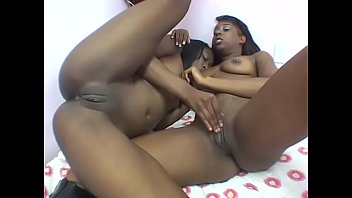 Sexy black cutie Taylor Starr eats her girlfriend's pussy before she gets fucked with a dildo