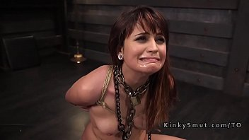 Gagged babe in ropes flogged and caned