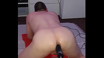 Getting pounded deep by 10 inch BBC dildo fucking machine whilst in chastity