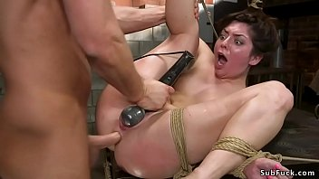 Hot brunette slave Keira Croft in suspension and other rope bondage positions is rough pussy and tight asshole banged by big cock master