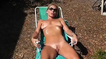 lady sunbathing with her naked pussy craving for cock