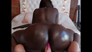 Ebony girl rides big ass with dildo