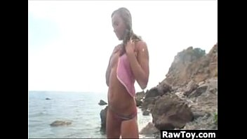 Teen Girl Outside On The Rocks With A Toy