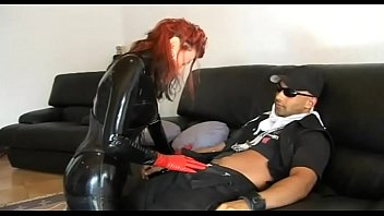 Hot redhead girl in latex seduces a worker