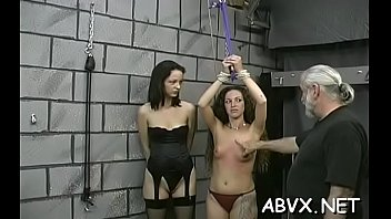 Hot scenes of rough slavery on breasty babe's pussy