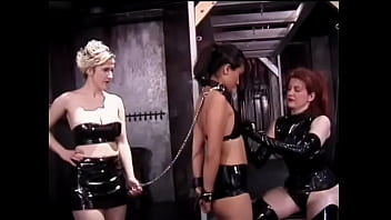 Two Lecherous Lesbians In Leather Lingerie Bondage A Slim Brunette With Small Breasts