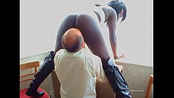 Ebony whore in knee high boots getting pussy licked