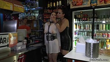 Mistress Fetish Liza in leather outfit shames and disgraces busty brunette Euro slut Lucia Love in the rain in Budapest