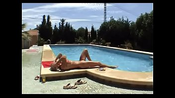 Hungarian milf Krisztina Sereny does anal from behind with her husband on the pool