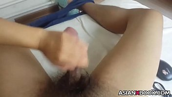 Asian babe gives handjob
