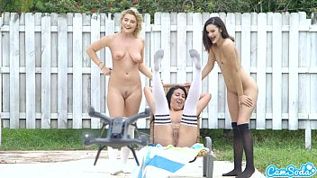lesbian teen threesome play tug a war with a drone pulling ping balls out of the